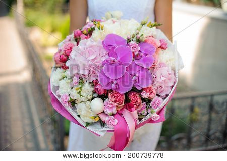 Bridal beautiful mixed bouquet and bride close up no face