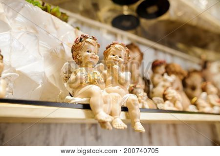 A pair of Christmas small guardian angels close up. Interior decor background