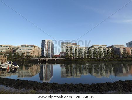 Mission Creek Park Waterway With Houseboats And Modern Buildings