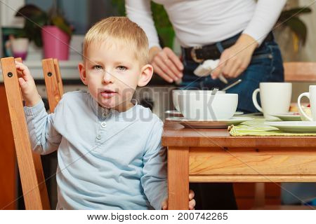 Morning routine in family healthy diet for children concept. Kid boy eating breakfast cereals and milk