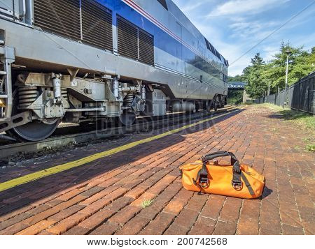 Kirkwood, Mo, USA - August 12, 2017: Morning Amtrak train, River Runner, from St Louis to Kansas City arrives at Kirkwood station.