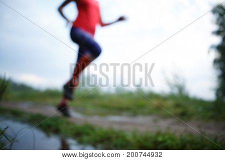 Blurred photo of running girl