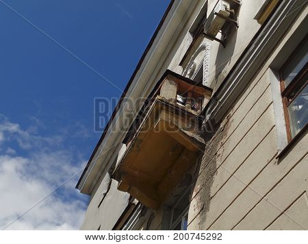 Balcony. Old balcony. Building. Old building. Old house with a balcony. Architectural background.