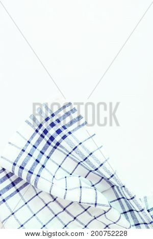 Blue Cloth, A Kitchen Towel With A Checkered Pattern, On A White