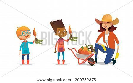 Laughing multiracial children holding carrots and female agricultural worker dressed in rubber boots and straw hat standing on one knee beside wheelbarrow full of pumpkins. Vector illustration