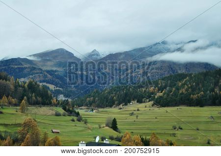 View Landscape And Agricultural Field With Alps Mountain In Bolzano Or Bozen At Italy