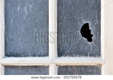 Broken Pane Of Glass In An Old Window