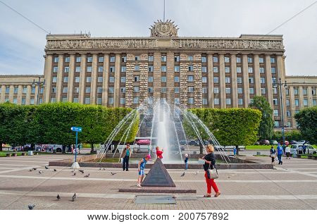 ST PETERSBURG RUSSIA-AUGUST 15 2017. The House of Soviets at Moscow square and the singing fountain on the foreground in St Petersburg Russia. St Petersburg Russia city view