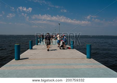 Seaside Heights NJ USA -- August 21, 2017 Anglers are fishing at a popular spot in Seaside Heights at the Jersey Shore. Editorial Use Only.