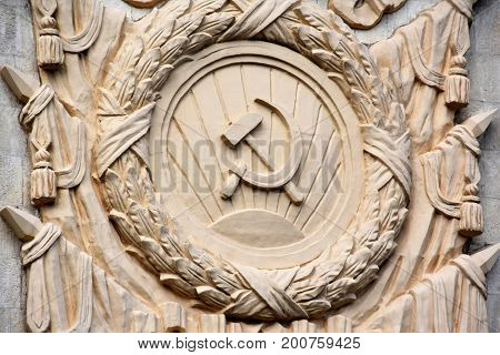 Bas-relief depicting the hammer and sickle of the USSR coat of arms