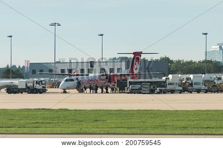 Stuttgart, Germany - August 17, 2017: A plane by the bankrupt German airline AirBerlin has landed and is embarking at the airport of Stuttgart, Germany.