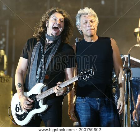 ENDICOTT, NY-Aug 18: Phil X (L) and Jon Bon Jovi perform in concert at En-Joie Golf Course on August 18, 2017 in Endicott, New York.