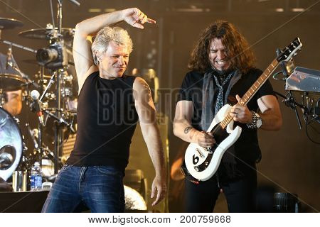 ENDICOTT, NY-Aug 18: Phil X (R) and Jon Bon Jovi perform in concert at En-Joie Golf Course on August 18, 2017 in Endicott, New York.