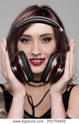 Young Woman Holding Big Headphones