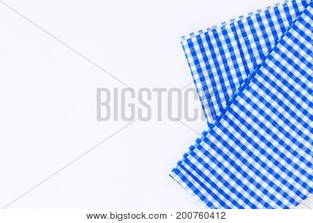 Blue cloth, a kitchen towel with a checkered pattern, on a white background isolated.