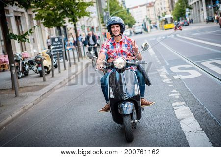 Young scooter driver in the streets of Berlin Mitte