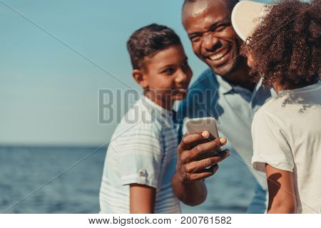 Father And Kids Using Smartphone