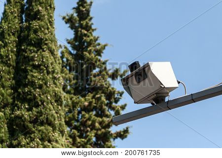 the camera of fixing of speed of the car which is freezing up over the road in summer day
