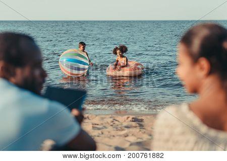 Kids Playing In Sea