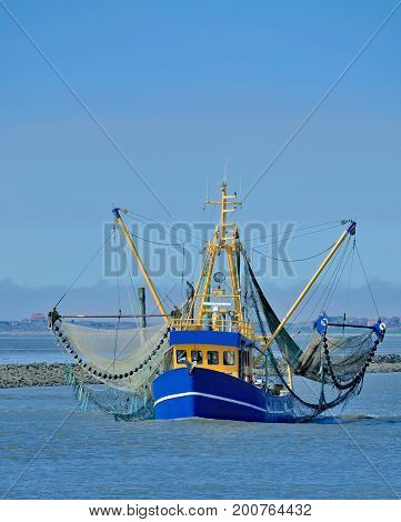 homecoming Shrimp Boat in East Frisia at North Sea,lower saxony,Germany poster