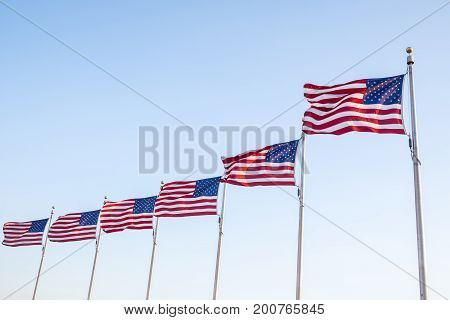 United States Flags Flying Against the Blue Sky
