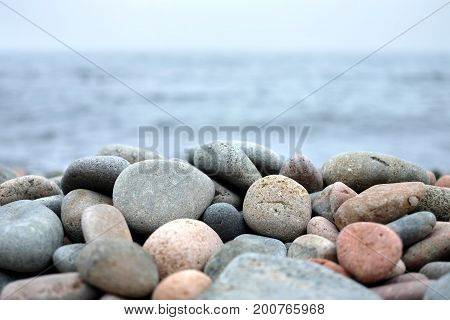 Round Sea Stones In Front Of Water