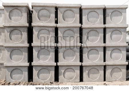Concrete manholes for use in construction job isolated on white background.