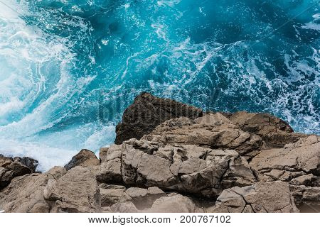 Rocky Cliff Contrast From Above With Crashing Blue Water Whitecaps  Perspective