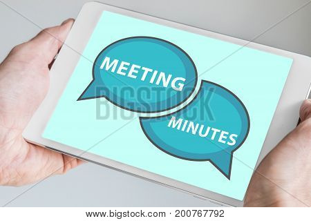Meeting minutes concept with hands holding modern tablet or smartphone to be used as slide background