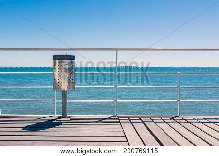 Sunny Day Beach Dock Trash Can Railing Blue Sky Wood Landscape View