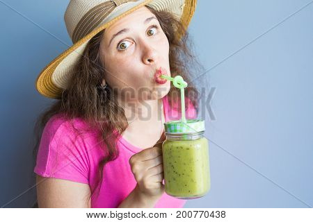 Organic Food. Healthy Eating Woman Drinking Fresh Raw Green Detox Vegetable Juice. Healthy Lifestyle, Vegetarian Meal. Drink Smoothie. Nutrition Concept and Diet