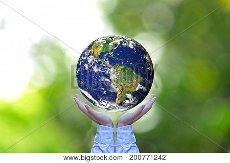 Holding a glowing earth globe in his hands. Saving World. Earth image provided by Nasa.