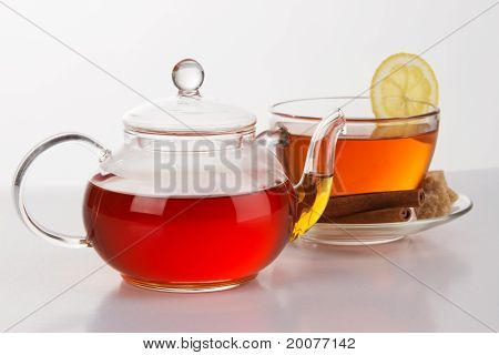 Teapot with a cup