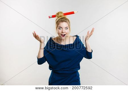 Shocked Blonde Woman Having Big Pencil In Hair