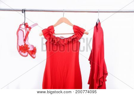 female two red dress ,shoes on hanger
