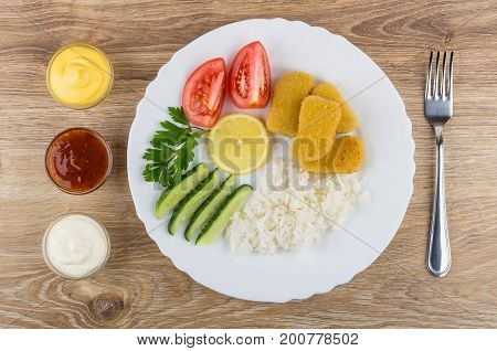 Chicken Nuggets With Rice, Vegetables, Lemon In Plate, Sauces