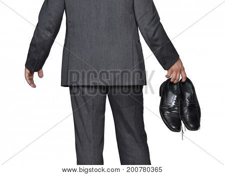 Businessman take off shoes. Hold shoes.