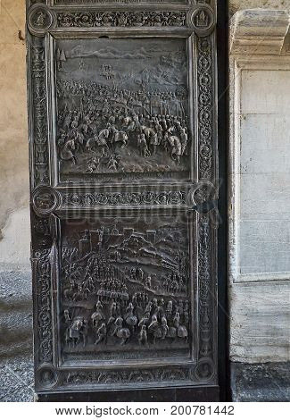 Naples, Italy - August 7, 2017. Bronze door located at the triumphal arch of Castel Nuovo Maschio Angioino of Naples. Campania Italy.