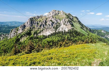 rocky dolomitian Velky Rozsutec hill in Mala Fatra mountains in Slovakia during nice day with blue sky and only few small clouds
