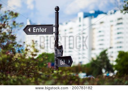 a Pointer with the directions. a Signboard sign