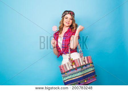 Portrait of beautiful young hippie woman in studio.