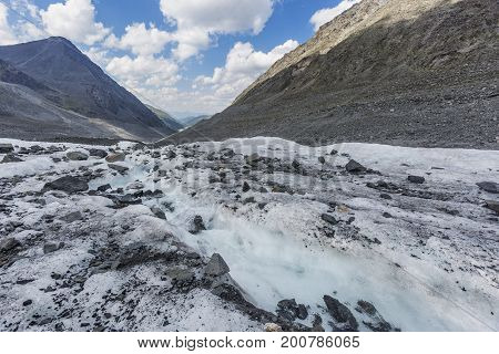 Clean Water In Creek. Glacier Akkem. Altai Mountains