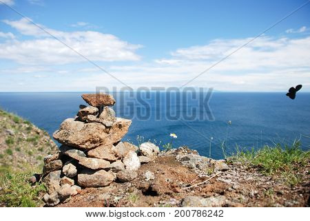 A pile of stones against the sea