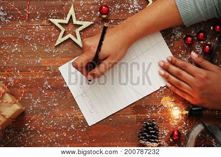 Christmas. Woman is writing a letter