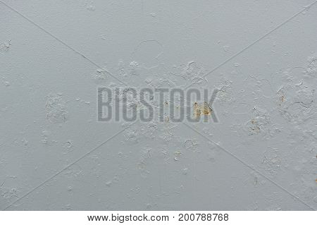 A gray old painted metal backdrop with rusty stains