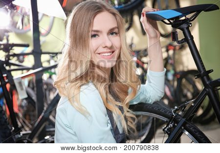Young woman in bicycle shop