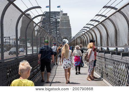 SYDNEY,NSW,AUSTRALIA-NOVEMBER 20,2016: Tourists walking footbridge to the Pylon Lookout at the Sydney Harbour Bridge with vehicles in Sydney, Australia.