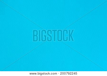 A blue artificial leather background texture close-up