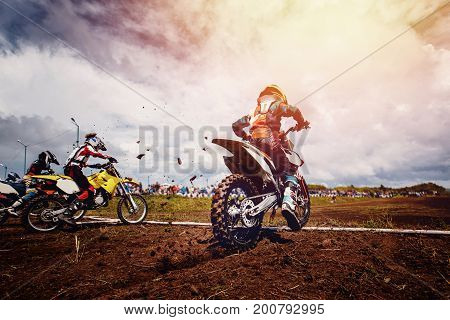 Team athletes on mountain bikes start. Concept motorcross stunts, bike.