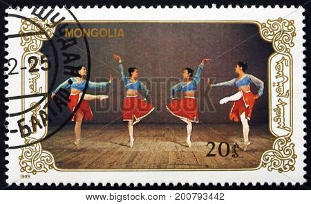 MONGOLIA - CIRCA 1990: a stamp printed in Mongolia shows Dancers in Scene from Ballet Mongolian Ballet circa 1990